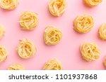 uncooked dry tagliatelle nests...   Shutterstock . vector #1101937868