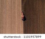 Aerial Shot Of A Farmer Plowin...