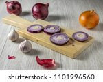 sliced red onion and garlic on...