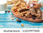 granola bar on wooden background | Shutterstock . vector #1101997400