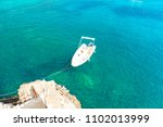 boat and turquoise sea in... | Shutterstock . vector #1102013999