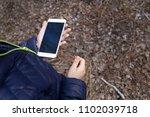 little boy using smartphone... | Shutterstock . vector #1102039718