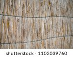 background from dry straw tied... | Shutterstock . vector #1102039760