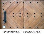 door handle knocker on the old... | Shutterstock . vector #1102039766