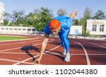 sprinter athlete male at... | Shutterstock . vector #1102044380