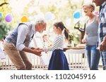family celebration or a garden...   Shutterstock . vector #1102045916