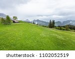 mountain view to the forest.... | Shutterstock . vector #1102052519