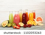 bottles with tasty juices and... | Shutterstock . vector #1102053263