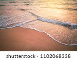 sunset beach and smooth wave... | Shutterstock . vector #1102068338