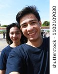 asian couple take photo selfie  | Shutterstock . vector #1102109030