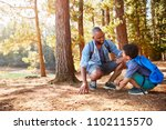 father and son on hiking... | Shutterstock . vector #1102115570