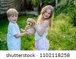 happy cute blond rosy cheeks... | Shutterstock . vector #1102118258
