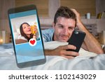 attractive man lying on bed on... | Shutterstock . vector #1102143029