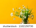 Wild Flowers In A Vase On...