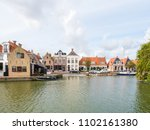 harbour with boats and quayside ... | Shutterstock . vector #1102161380