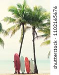 surfboard and palm tree on... | Shutterstock . vector #1102165676