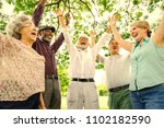senior friends having fun at... | Shutterstock . vector #1102182590
