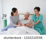 happy elderly woman talking... | Shutterstock . vector #1102210538