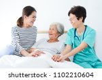 happy elderly woman talking... | Shutterstock . vector #1102210604