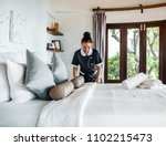housekeeper cleaning a hotel... | Shutterstock . vector #1102215473