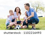 family of four outdoors in a... | Shutterstock . vector #1102216493