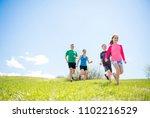 parents with children sport... | Shutterstock . vector #1102216529