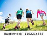 parents with children sport... | Shutterstock . vector #1102216553