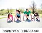 parents with children sport... | Shutterstock . vector #1102216580