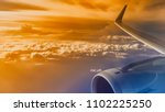 wing of an airliner plane in... | Shutterstock . vector #1102225250