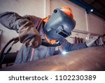 male  worker wearing protective ... | Shutterstock . vector #1102230389