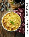 homemade shepherd's pie with... | Shutterstock . vector #1102247549