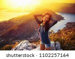 happy woman in the mountains... | Shutterstock . vector #1102257164
