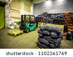 bags and crates of potato in... | Shutterstock . vector #1102261769