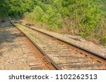 old railroad tracks passing... | Shutterstock . vector #1102262513