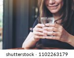 closeup image of woman holding... | Shutterstock . vector #1102263179