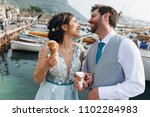 funny newlyweds eat ice cream... | Shutterstock . vector #1102284983