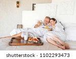mature couple in a luxurious... | Shutterstock . vector #1102293473
