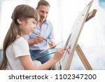 best dad helping his daughter... | Shutterstock . vector #1102347200