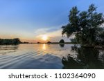 sunset in the danube delta ... | Shutterstock . vector #1102364090