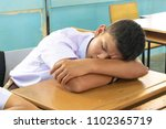 student take a nap in classroom   Shutterstock . vector #1102365719