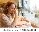 young woman in sorrow crying... | Shutterstock . vector #1102367033