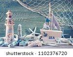 marine life decoration on blue... | Shutterstock . vector #1102376720