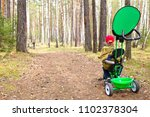 baby boy on the forest path | Shutterstock . vector #1102378304
