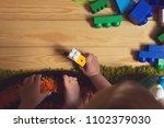 baby boy holding toys | Shutterstock . vector #1102379030