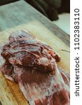 Small photo of Delicious raw thick skirt steak, in the wooden board. Argentine court very consumed in barbecues