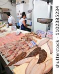 """Small photo of Cadiz, Spain - Aug 25, 2012: Stall selling fresh fish in the market, freshly caught hake, sole, cuttlefish and squid """"merluza, lenguados, chocos y calamares"""", Cádiz, Spain"""