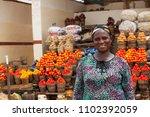african woman selling fresh... | Shutterstock . vector #1102392059