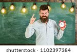 teacher in eyeglasses holds... | Shutterstock . vector #1102397384