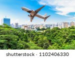 singapore city in forest with... | Shutterstock . vector #1102406330