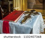 a silver cross and a bible in... | Shutterstock . vector #1102407368